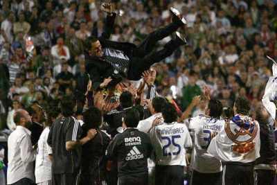 Madrid, SPAIN: Real Madrid's Italian coach Fabio Capello is thrown in the air after Real won the Spanish league title by beating Mallorca in the final Spanish league football match of the season, 17 June 2007 at the Santiago Bernabeu stadium in Madrid. Real won 3-1 to win their 30th league title. AFP PHOTO/BRU GARCIA (Photo credit should read BRU GARCIA/AFP/Getty Images)