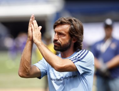 New York City FC's Andrea Pirlo (21), of Italy, acknowledges an ovation from the crowd as he walks off the field after warming up before an MLS soccer game against Orlando City SC at Yankee Stadium, Sunday, July 26, 2015, in New York. (AP Photo/Jason DeCrow)