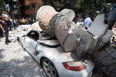 447CD33400000578-4900334-This_car_was_left_crushed_under_falling_debris_during_the_7_1_ma-a-122_1505883564030