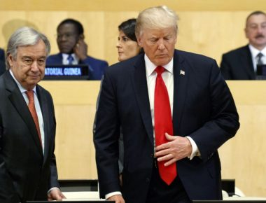 """President Donald Trump takes his seat as he arrives with United Nations Secretary General Antonio Guterres for the """"Reforming the United Nations: Management, Security, and Development"""" meeting during the United Nations General Assembly, Monday, Sept. 18, 2017, in New York. (AP Photo/Evan Vucci)"""