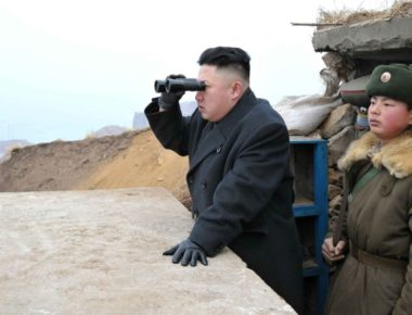 """This picture, taken by North Korea's official Korean Central News Agency on March 7, 2013 shows North Korean leader Kim Jong Un (C) using a pair of binocular to look south as he inspects Jangjae Islet Defence Detachment near South Korea's Taeyonphyong Island in South Hwanghae province, North Korea's southwestern sector of the front.   AFP PHOTO / KCNA via KNS ---EDITORS NOTE--- RESTRICTED TO EDITORIAL USE - MANDATORY CREDIT """"AFP PHOTO / KCNA VIA KNS"""" - NO MARKETING NO ADVERTISING CAMPAIGNS - DISTRIBUTED AS A SERVICE TO CLIENTS        (Photo credit should read KNS/AFP/Getty Images)"""