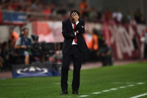 Olympiacos' Albanian head coach Besnik Hasi reacts during the UEFA Champions League Group D football match between Olympiacos Piraeus FC and Sporting Lisbon on September 12, 2017 at the Karaiskaki stadium in Athens. / AFP PHOTO / ARIS MESSINIS        (Photo credit should read ARIS MESSINIS/AFP/Getty Images)