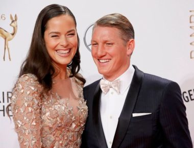 German-soccer-player-Schweinsteiger-and-his-wife-Serbian-tennis-player-Ivanovic-arrive-on-the-red-ca
