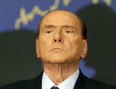 "FILE In this Sept. 27, 2012 file photo Silvio Berlusconi attends the presentation of a book in Rome. Berlusconi is backing off from suggestions he may be seeking a comeback. He is even hinting he could support in the next elections Mario Monti, the non-political economist named to succeed him as premier to steer the country away from financial disaster. The 76-year-old media mogul said in an interview on a family-controlled TV station Tuesday that he could take ""a step backward"" to allow moderates to form a coalition that could defeat the left in elections in the spring. Berlusconi says he ""wouldn't exclude"" Monti as leader of such a moderate group. (AP Photo/Alessandra Tarantino, File)"