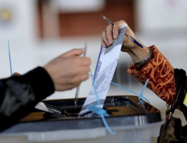 epa06282008 A woman casts her vote at a voting center in Pristina, Kosovo, 22 October 2017. Some 1.8 million voters are called to take part on the first round of municipality elections to elect mayors and assembly members.  EPA-EFE/VALDRIN XHEMAJ