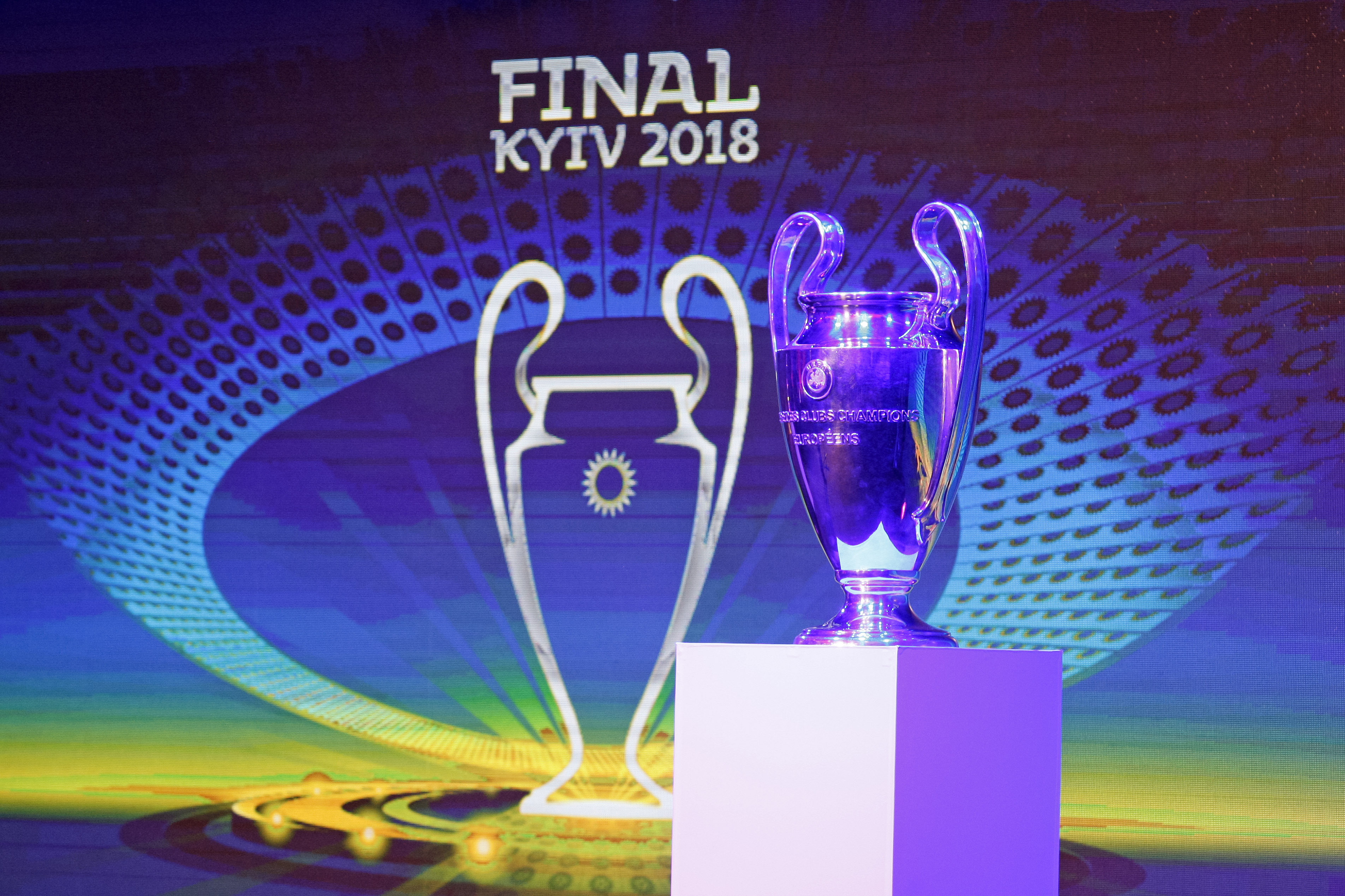 December 12, 2017 - Kiev, Ukraine - The Champions League trophy and the logo of the 2018 UEFA Champions League final on display, during the presentation of the logo of the 2018 UEFA Champions League final in Kiev, Ukraine, on 12 December 2017. The UEFA Champions League final will be played at the Olimpiyskiy stadium in Kiev on 26 May 2018. (Credit Image: © Serg Glovny via ZUMA Wire)