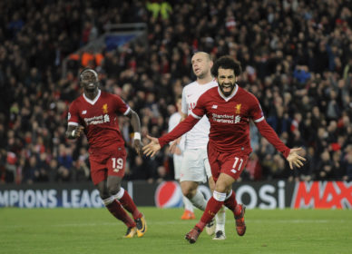 Liverpool's Mohamed Salah, right, celebrates after scoring his side's seventh goal during the Champions League Group E soccer match between Liverpool and Spartak Moscow at Anfield, Liverpool, England, Wednesday, Dec. 6, 2017. (AP Photo/Rui Vieira)