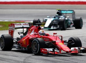KUALA LUMPUR, MALAYSIA - MARCH 29:  Sebastian Vettel of Germany and Ferrari drives ahead of Nico Rosberg of Germany and Mercedes GP during the Malaysia Formula One Grand Prix at Sepang Circuit on March 29, 2015 in Kuala Lumpur, Malaysia.  (Photo by Mark Thompson/Getty Images)