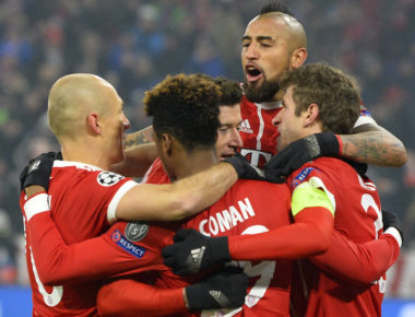 French midfielder Kingsley Coman (C-front) celebrates with teammates after he scored during the UEFA Champions League round of sixteen first leg football match Bayern Munich vs Besiktas Istanbul on February 20, 2018 in Munich, southern Germany. / AFP PHOTO / THOMAS KIENZLE        (Photo credit should read THOMAS KIENZLE/AFP/Getty Images)