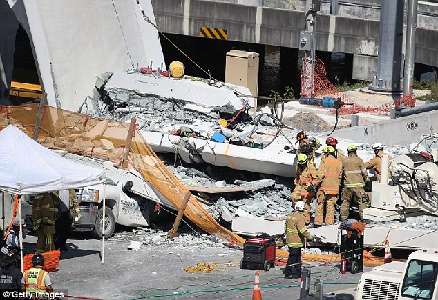 4A3AE40000000578-0-Miami_Dade_Fire_Rescue_Department_workers_work_at_the_scene_of_t-a-47_1521208227399