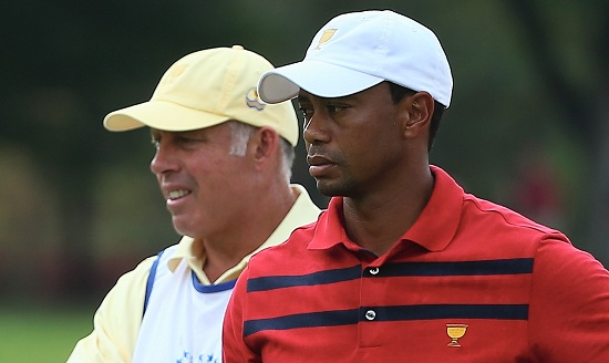 DUBLIN, OH - OCTOBER 05: Tiger Woods of the U.S. Team waits near International Team caddie Steve Williams on the 13th hole during the Day Three Four-ball Matches at the Muirfield Village Golf Club on October 5, 2013 in Dublin, Ohio. Andy Lyons/Getty Images/AFP
