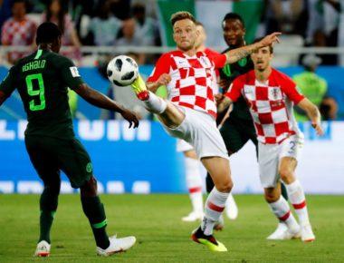 Soccer Football - World Cup - Group D - Croatia vs Nigeria - Kaliningrad Stadium, Kaliningrad, Russia - June 16, 2018   Croatia's Ivan Rakitic in action with Nigeria's Odion Ighalo      REUTERS/Fabrizio Bensch