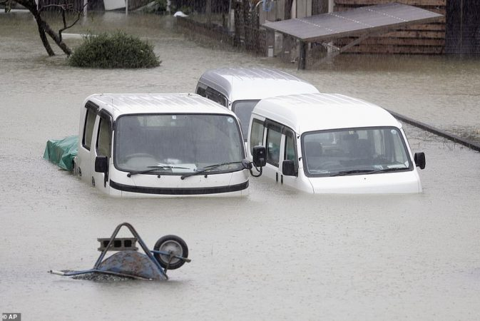 19624936 7565683 Cars Submerged In Water In A Residential Area Hit By The Dramati A 5 1570897039707 Copy