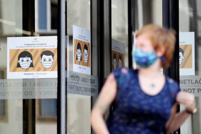 File Photo: A Woman Wearing A Face Mask Leaves A Shopping Mall In Prague