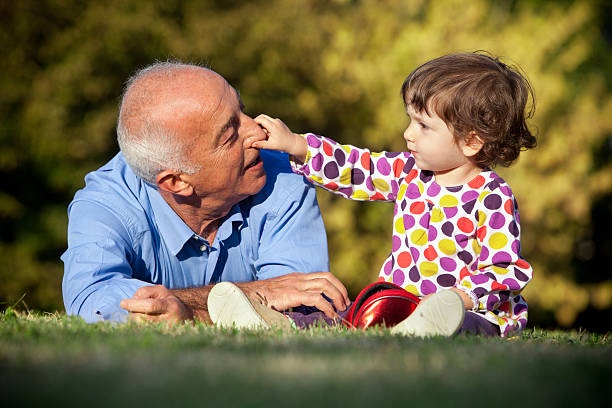 Grandpa And Niece At Park, Child Grabbing Man's Nose.