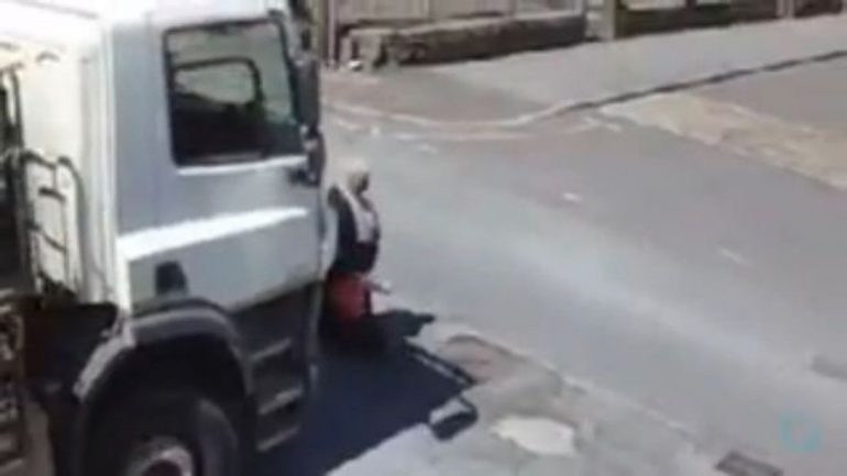 0 Shocking Moment Woman Screams In Fear As She Is Nearly Crushed By Truck When Driver Fails To Spot He 1