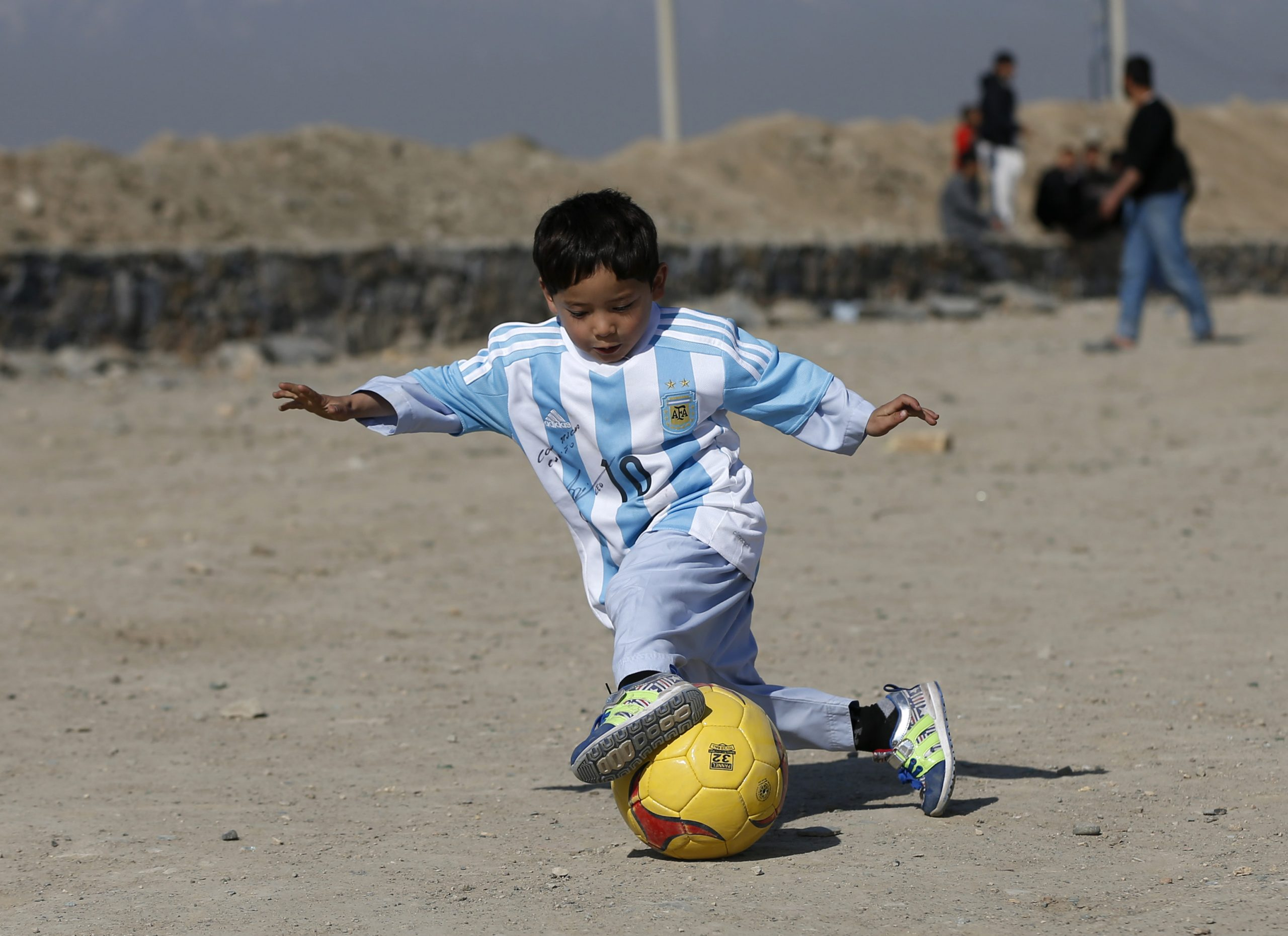 Five Year Old Ahmadi, An Afghan Messi Fan, Wears A Shirt Signed By Barcelona Star Messi, As He Plays Football At The Open Area In Kabul